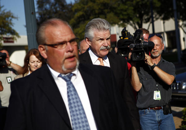 Will County State's Attorney James Glasgow, center, arrives at the Will County Courthouse in Joliet Thursday as the jury resumes deliberation.