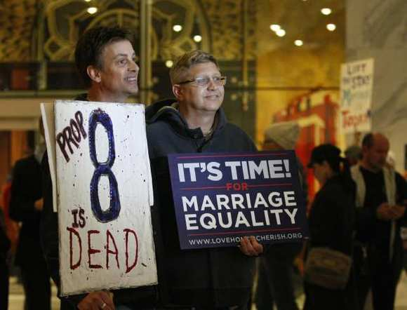 Steve Ledoux, left, and his spouse, Mark Becktold, who were married before Proposition 8 was passed, are shown in February celebrating an appellate panel ruling striking down the measure.