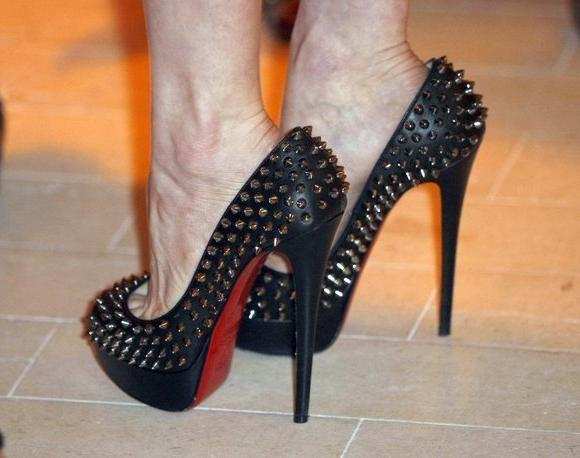 The signature red soles of Louboutin