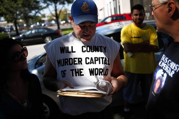"Bobby Hauert, of Elwood, wears a shirt calling Will County the ""murder capital of the world"" outside the Will County Courthouse as the jury continues its deliberation in the Drew Peterson trial. Hauert said his sister Cheryl Nugent was murdered in Will County in 1996."