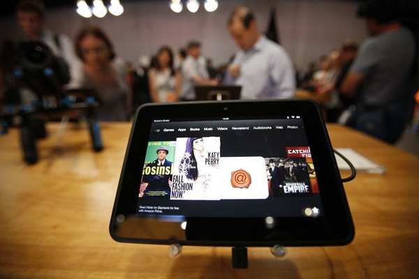 Journalists try out the Amazon Kindle Fire HD in Santa Monica.