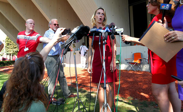 Pamela Bosco, a spokesperson for the family of Stacy Peterson, talks to reporters outside the Will County Courthouse after Drew Peterson was found guilty in the murder of Kathleen Savio.