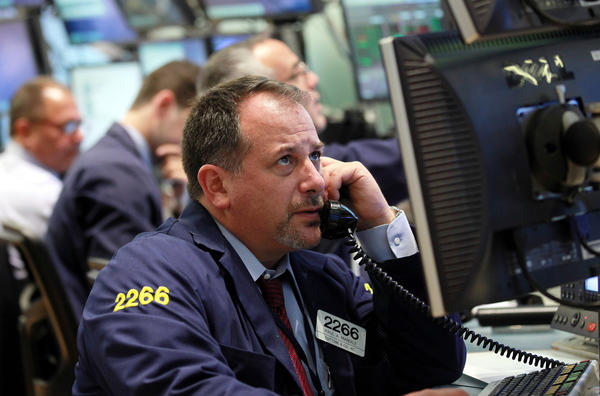 Broker Paul A. Mandile works the trading floor of the New York Stock Exchange a short time after the opening bell at the New York Stock Exchange up Thursday.