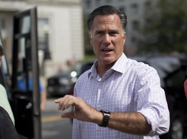 Mitt Romney speaks with the news media after visiting with veterans in Concord, N.H.