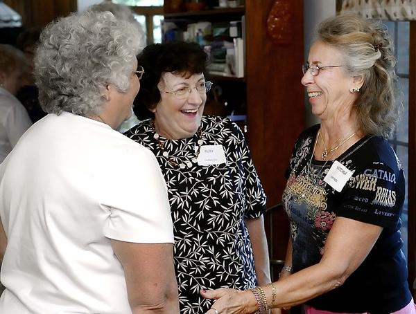 Sylvia Ridenour, left, Ruby Carbaugh and Victoria Hastings share a laugh at a luncheon held for former nurses of Western Maryland State Hospital.