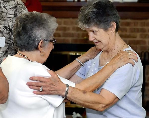 Lorraine Hays, left, and Jo Ann Peterson greet each other at a luncheon held for former nurses of Western Maryland State Hospital.