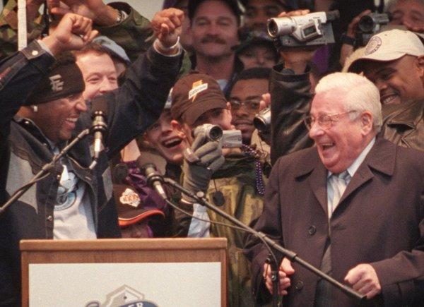 Ravens linebacker Ray Lewis coaxes then-Ravens owner Art Modell to do a little dance during a rally in January 2001, celebrating the the Ravens Super Bowl.