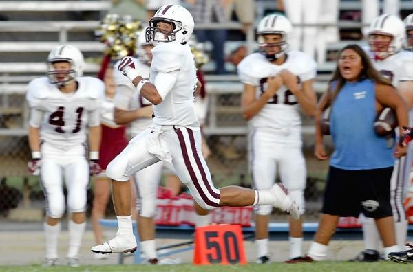 Laguna Beach High's Robert Clemens returns the kickoff for a touchdown during the first quarter against Bolsa Grande on Friday.