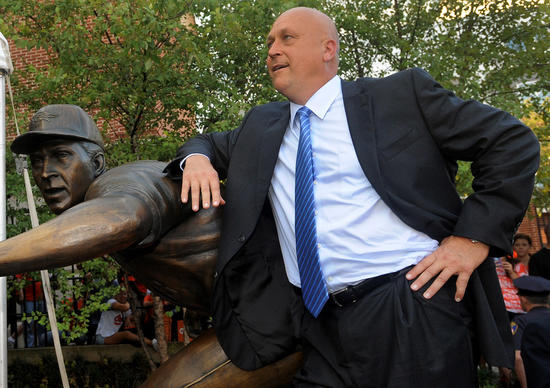 Cal Ripken Jr. has some fun with the media as he mugs with his sculpture following the unveiling ceremony at Camden Yards.