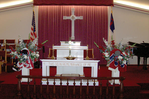 The church's altar was decorated in red, white and blue flower arrangements with flags from both sides of the Civil War.
