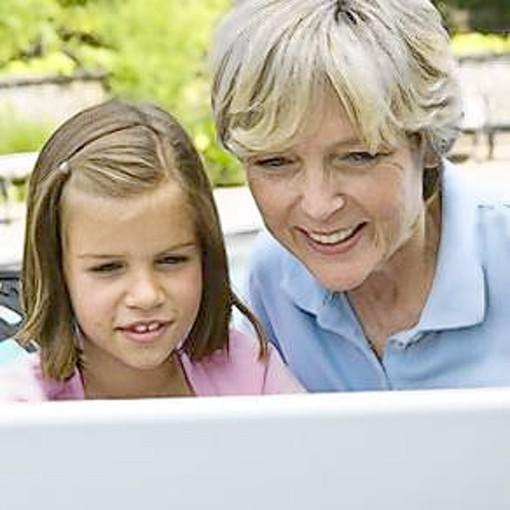 mother daughter outside on computer