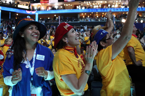New Mexico delegates sing along as singer James Taylor performs some of his hits at the Time Warner Cable Arena in Charlotte N.C. for the Democratic National Convention.