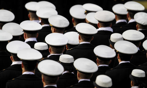 Navy Midshipmen stand in formation before an NCAA college football game against Army.