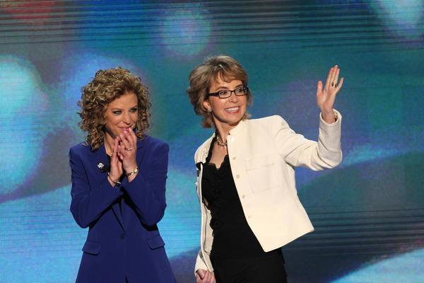 Former U.S. Rep. Gabrielle Giffords, right, arrives on stage with assistance from DNC chair Debbie Wasserman Schultz during the Democratic National Convention at Time Warner Cable Arena in downtown Charlotte, N.C.