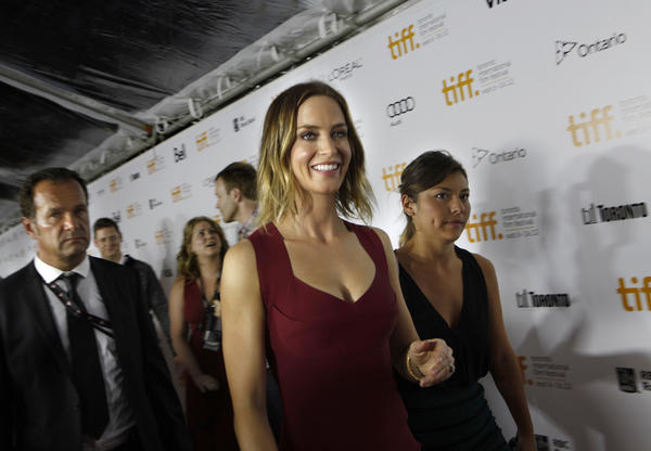 "Actress Emily Blunt stars as Sara in ""Looper,"" a futuristic action thriller, which premiered at the Toronto International Film Festival. <style type=""text/css"">