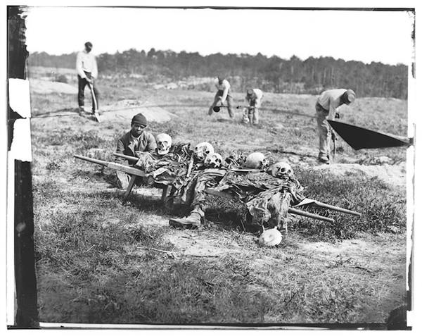 African American soldiers collect bones from the field, nearly a year after Battles of Cold Harbor and Gaines' Mill. April 1865.