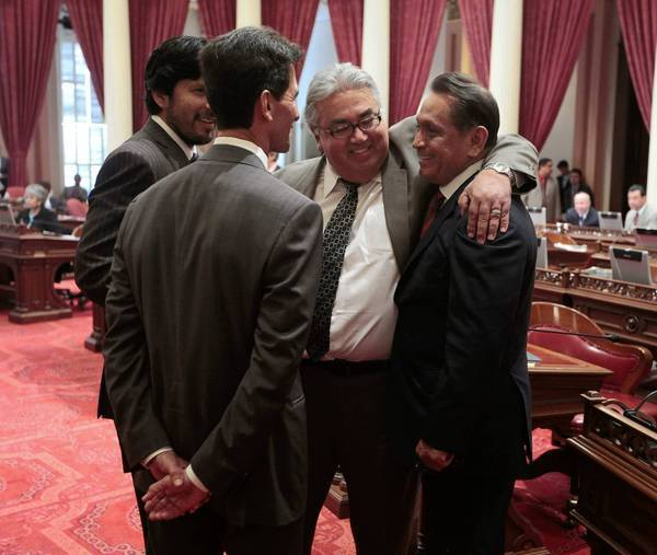 Assemblyman Gil Cedillo, right, is congratulated by state Sens. Kevin de Leon, left, Mark Leno, second from left, and Ron Calderon after the Senate approved his measure last week to allow illegal immigrants to get driver's licenses.