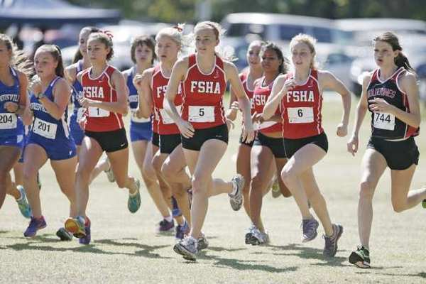 FSHA's Maddie Peterson, center, and other runners sprint off at the start line during the Mission League cross-country opener at Balboa Park in Encino.