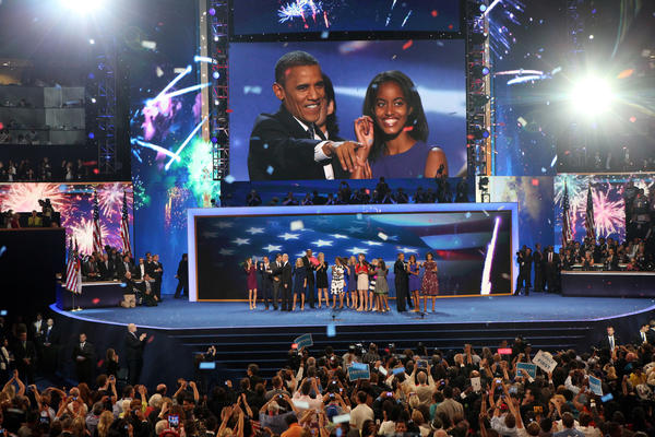 Pictured on the big screen, President Barack Obama and Malia Obama are all smiles at the Time Warner Cable Arena in Charlotte N.C., following the president's address to the Democratic National Convention.