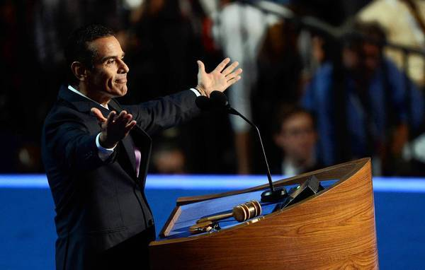L.A. Mayor Antonio Villaraigosa speaks at the Democratic National Convention.Villaraigosa took aim at Mitt Romney's suggestion that cracking down on illegal immigrants would persuade many of them to leave the United States of their own will.