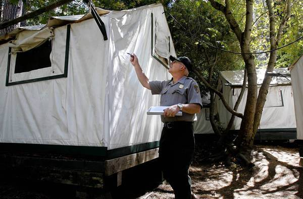 Glenn Dean, an occupational safety and health specialist, inspects tent cabins for mouse entry points Aug. 28 at Yosemite National Park's Curry Village. Hantavirus is spread through urine, droppings or saliva of infected rodents.