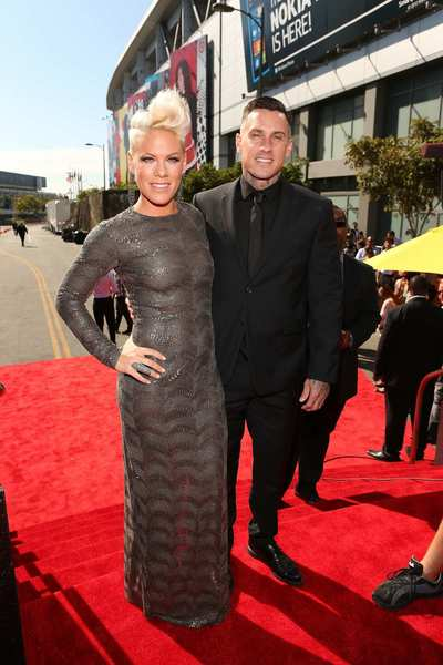 Singer Pink and professional motocross rider Carey Hart arrive at the show.