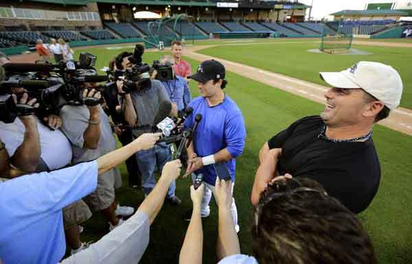 Roger Clemens and son Koby field questions from reporters during a news conference in Sugar Land, Texas.