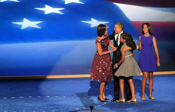 First Lady Michelle Obama and daughters Sasha, left, and Malia join President Obama on stage after his speech accepting the Democratic nomination.