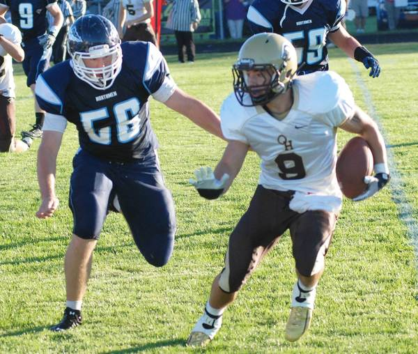 Petoskey senior Will McMasters (left) bears down on Brandon Benac of West Branch Ogemaw Heights during a 34-8 Northmen victory last week at Curtis Field. The Northmen play host to Cadillac today, Friday, in a battle of 2-0 teams.