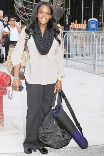 """""""I normally don't have this much stuff. I normally (just) have my tote (the bag on her right shoulder) and try to fit everything in there. Normally I even have my laptop in there, and lunch goes in there too. I'm going to yoga, and this (black bag) is my workout bag.""""<br><br>  What's right: Despite all that gear -- three separate pieces -- she looks chic and put together.<br><br>  What's wrong: The Gucci bag she uses as a tote is heavy, even when it's empty. And she confesses she's hauling two big bottles of water -- one sparkling, one regular -- a large cosmetics bag and more. """"I guess I do need to clean out my bag."""" Miniature cosmetics, less water, a lighter tote bag would help."""