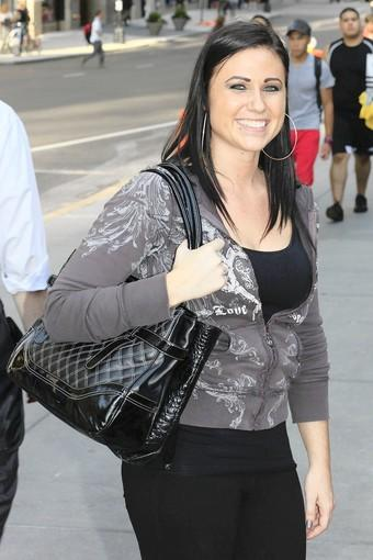 """""""I just run out of the house in the morning, so I throw in everything that fits,"""" she says. She's carrying a purse on top of her black tote.<br><br>  What's right: The bags don't look stuffed, even though she carries a change of clothes in one of them, a requirement for school.<br><br>  What's wrong: She carries two, and sometimes three, heavy, glass, full-size perfume bottles in her purse because she likes options during the day. Limit scent to one a day."""