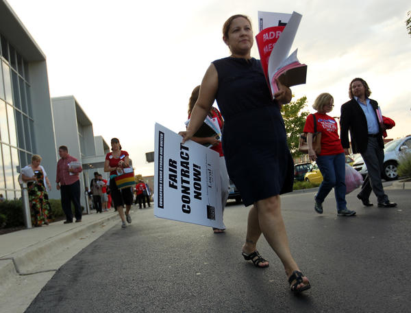 Chicago Teachers Union members leave with strike materials after a union delegate meeting on Wednesday.