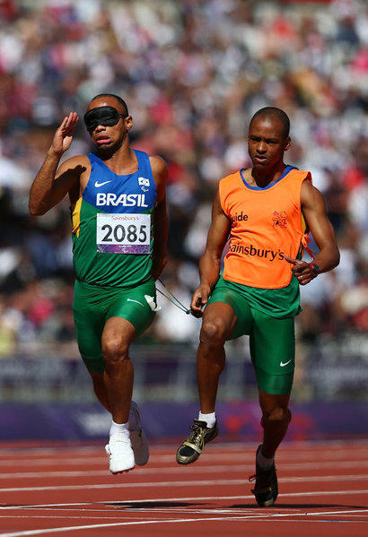 Felipe Gomes and Leonardo Souza Lopes (guide) of Brazil compete in the Men's 100m ¬ó T11 heats on day 9 of the London 2012 Paralympic Games at Olympic Stadium on September 7, 2012 in London, England.