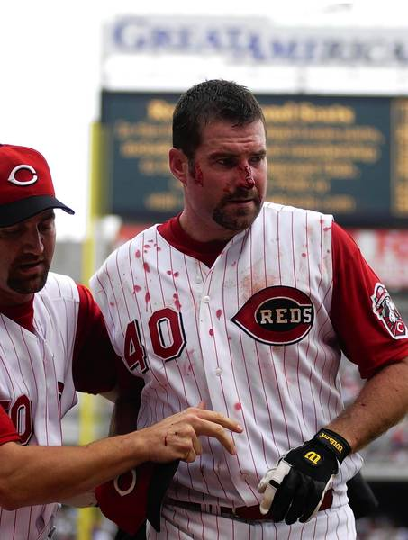 Cincinnati Reds pitcher Paul Wilson (40) is led from the field by Kent Mercker after Wilson was ejected following a fight against the Chicago Cubs Kyle Farnsworth.