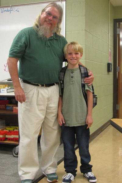 Gage Anderson poses for a photo with his third grade teacher Mike Myers.