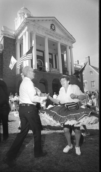 On Connecticut Day at the Big-E in 1995, groups  from around the state gathered to square dance. At left is Bill Kinney of Meriden, a member of the Cheshire Cats square dance group, and at right is Pat Powers of East Hampton, a member of the Marlborough Squares group.