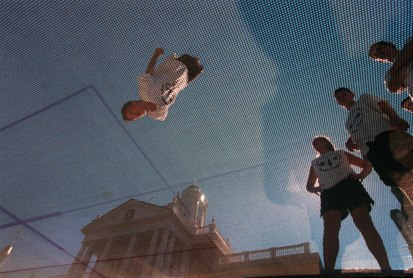 Kyle Bowen, 16, of Killingly, flips head over heels on a trampoline in 2000. He and other young trampolinists from The Trampoline Place in Pomfret put on an exhibition in front of the Connecticut Building on Connecticut Day at the Big E.