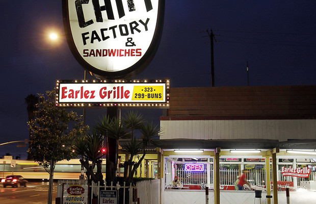 Metro Expo Line rail cars roll past Earlez Grille at the intersection of Crenshaw and Exposition boulevards. A new rail line is to run from the Expo Line down Crenshaw Boulevard for 8.5 miles and connect with the Metro Green Line.(Luis Sinco / Los Angeles Times)