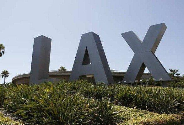 The initials greeting arrivals at an entrance to LAX.