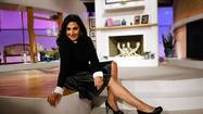 Ricki Lake jumps off the couch and struts across the expansive set of her new talk show in a pair of killer black YSL Trib Toos.