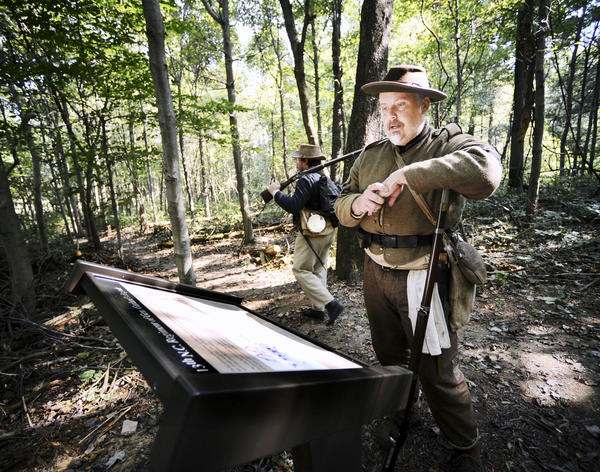Travis Hebert reads information on one of the new markers placed Friday along the General Garland Trail near Fox's Gap to honor the 13th North Carolina Infantry Regiment and the 50th Georgia Infantry Regiment.