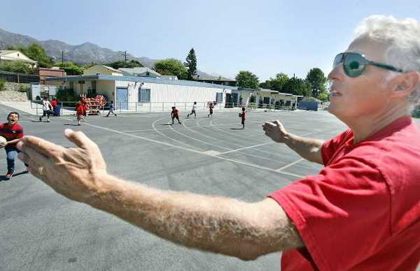 Principal Stephen Williams spans his arms to show all of the bungalow classrooms that will be replaced at Lincoln Elementary School in La Crescenta where a portion of $270-million in Measure S funds will be spent.