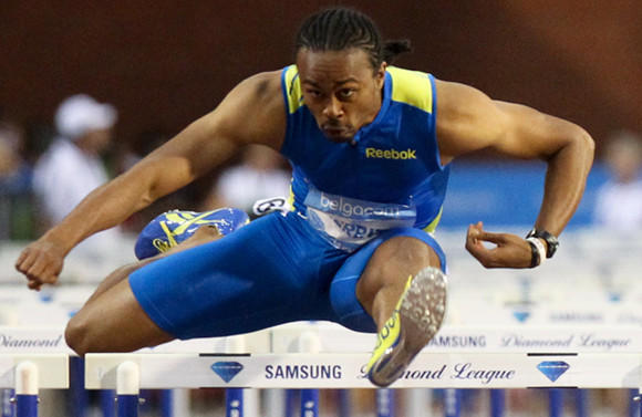 Aries Merritt in his world-record race Friday.  (Eric Lalmand / AFP / Getty Images)