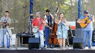 Thirty-two bluegrass bands performing on three stages, 76 barbecuers competing for a state title, food concessions and a beer garden add up to a weekend of music, the aroma of wafting grilled meat and Pickin' in the Panhandle.