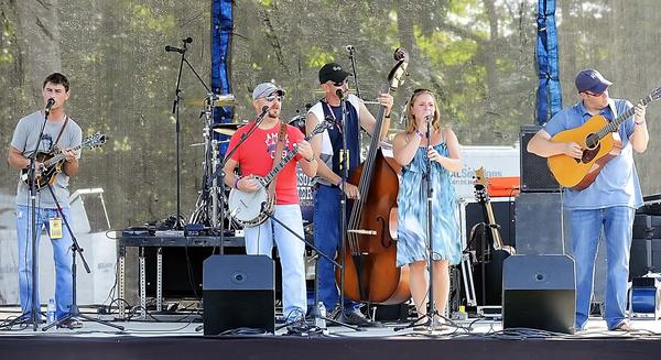 The Half Bad Bluegrass Band performs on the Main Stage at the opening day of Pickin' in the Panhandle at the Lazy A Campground near Glengary, W.Va., on Friday.
