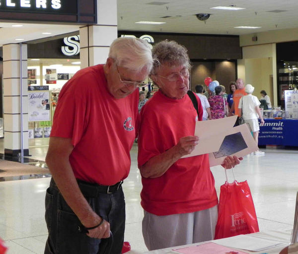 Bob Sedlor, 84, and his wife Lillian, 83, of St. Thomas (Pa.) check out information at one of the 80 displays set up at the Senior Fair at the Chambersburg Mall on Friday. The annual event was hosted by state Rep. Rob Kauffman.
