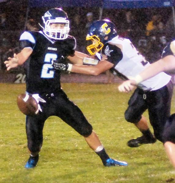 Petoskey quarterback Quinn Ameel (2) loses the ball under pressure from Cadillac's Aaron Gruber Friday during the Vikings' 44-14 victory over the Northmen at Curtis Field.