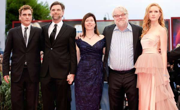 "Joacquin Phoenix (L to R), director Paul Thomas Anderson, producer Joanne Sellar, actor Philip Seymour Hoffman and actress Madisen Beaty pose on the red carpet as they arrive for a screening of the movie ""The Master."""