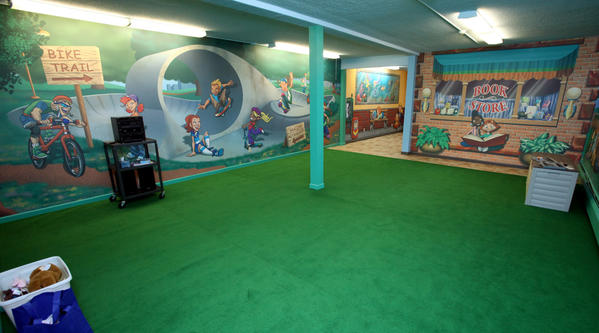 "Bright street scenes cover the walls in the ""Kid Street"" children's area at Calvary Baptist Church."
