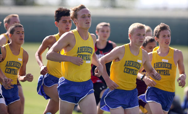 Members of the Aberdeen Central boys cross country team take off at the start of Friday's Bob Salmi/Al Sahli meet at Lee Park Golf Course. photo by john davis taken 9/7/2012
